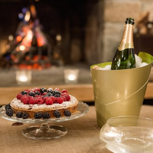 Afternoon tea aperitif, perrier jouet and berry cake, fire