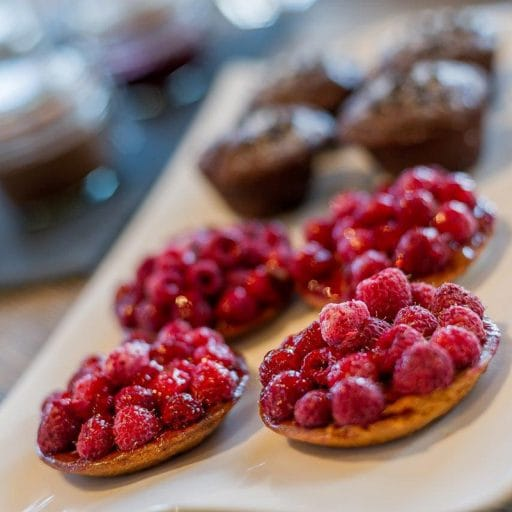 raspberry tart served for afternoon tea in luxury ski chalet