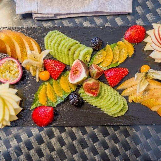 pretty fruit salad platter, how to present food in a luxury ski chalet