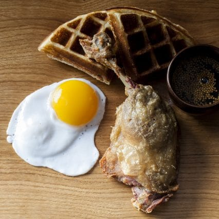 Duck and waffles with egg.