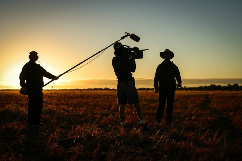 film crew against a sunset